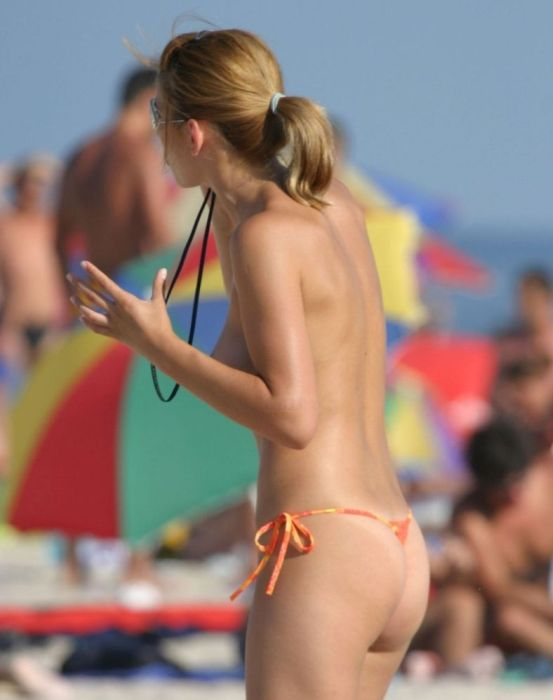 Topless girl on the beach - 00