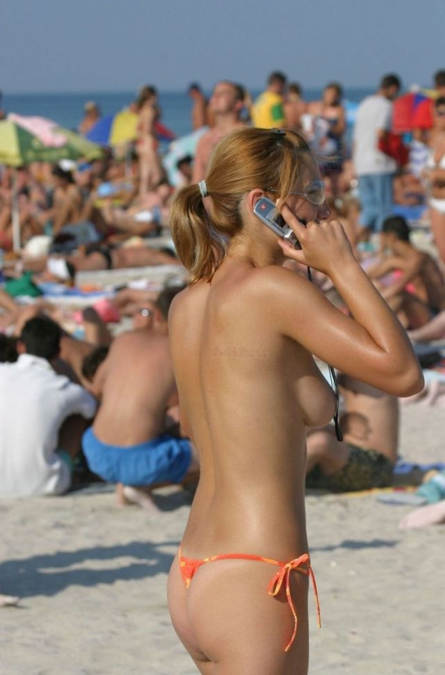Topless girl on the beach - 02