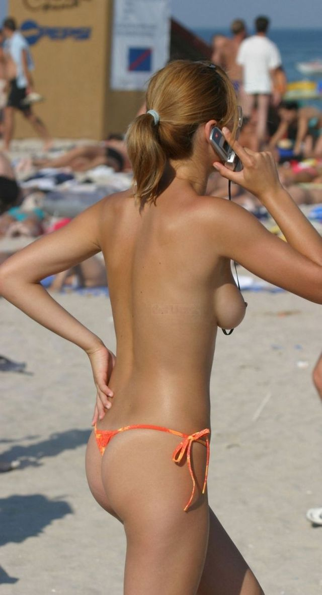 Topless girl on the beach - 07