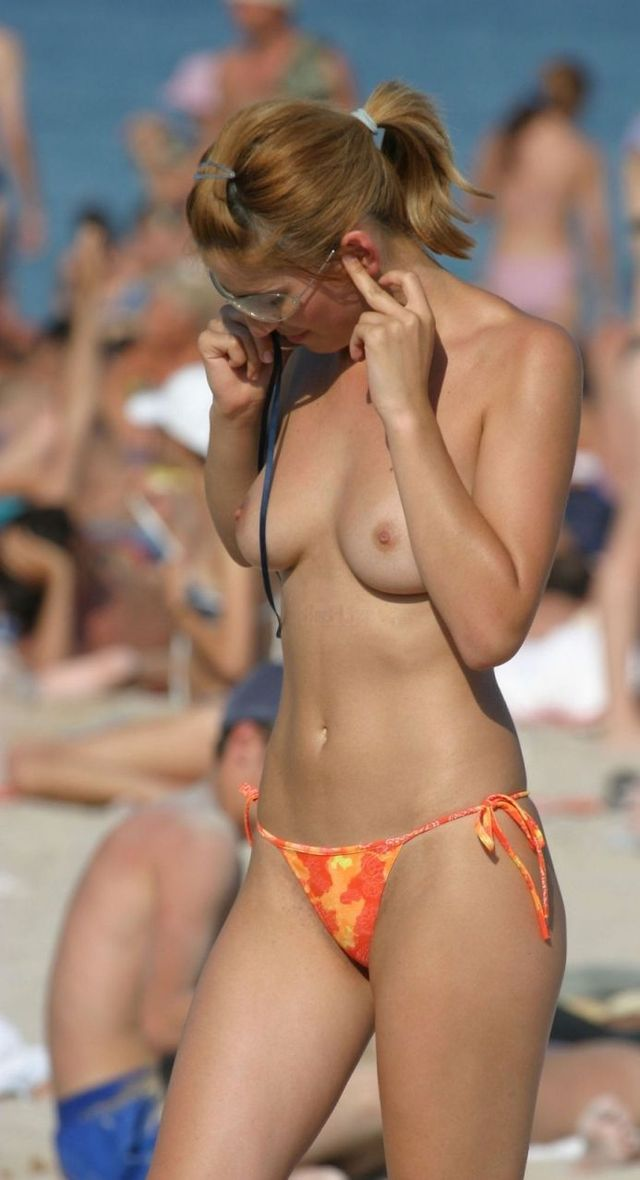 Topless girl on the beach - 09
