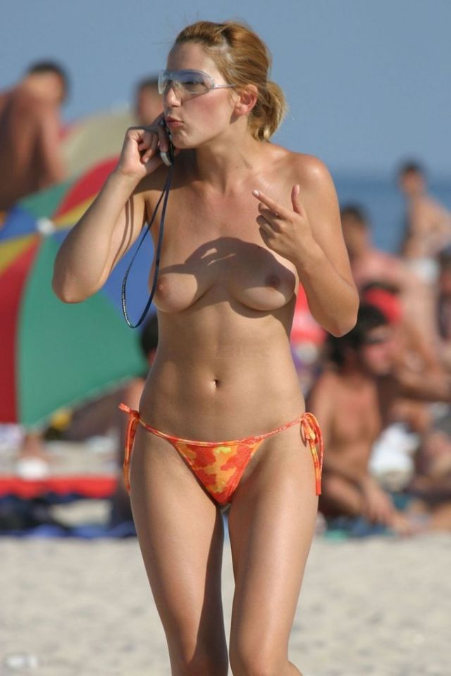 Topless girl on the beach - 13