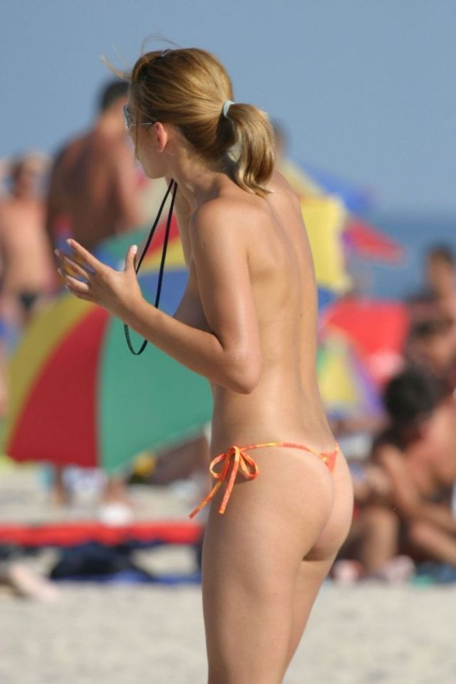 Topless girl on the beach - 14