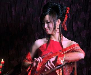 Asian babe and musical instruments. Very nice