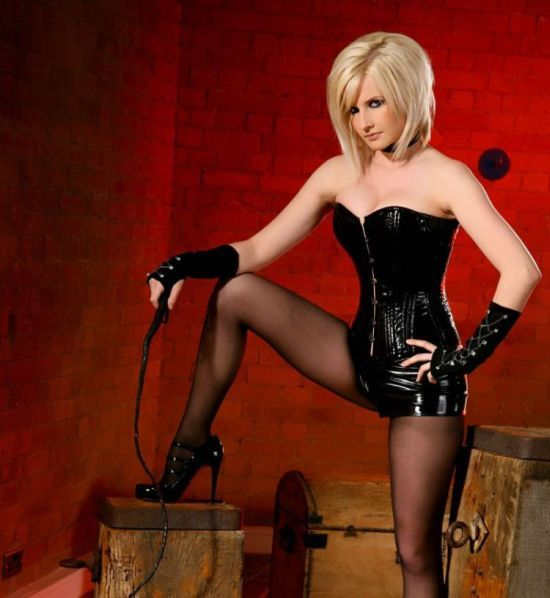 Michelle Marsh in a black corset and torn pantyhose - 00