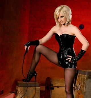 Michelle Marsh in a black corset and torn pantyhose