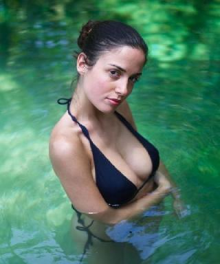 Girl with a stunning body posing in water
