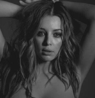 Glamour model Keeley Hazell in a black and white photo shoot