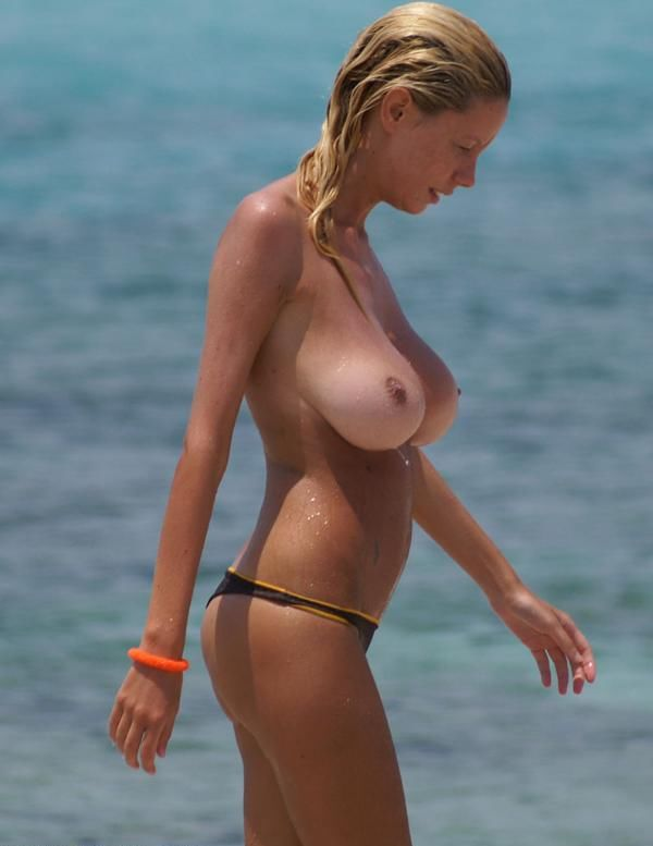 Beauty with a magnificent breasts on the beach - 07