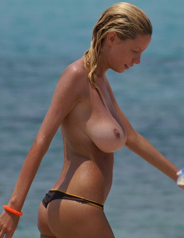 Beauty with a magnificent breasts on the beach - 08