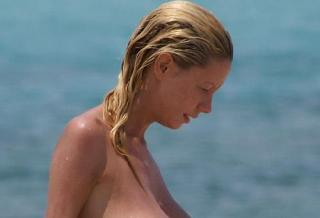 Beauty with a magnificent breasts on the beach