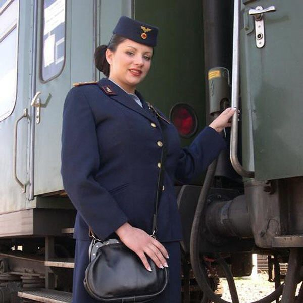 Gorgeous train attendant. It is a pity that I have not come across such attendants - 00