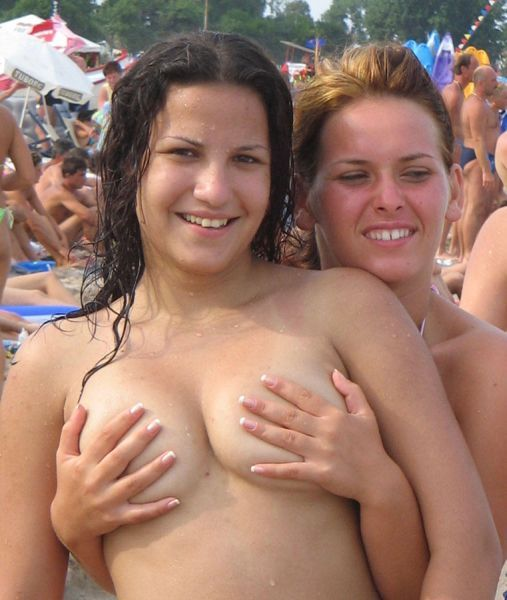Girls like to be photographed topless on the beach - 00
