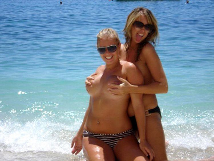 Girls like to be photographed topless on the beach - 22
