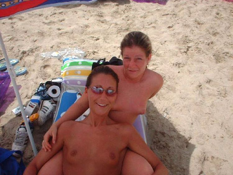 Girls like to be photographed topless on the beach - 28