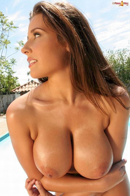 Big-breasted Erica Campbell near a pool - 11