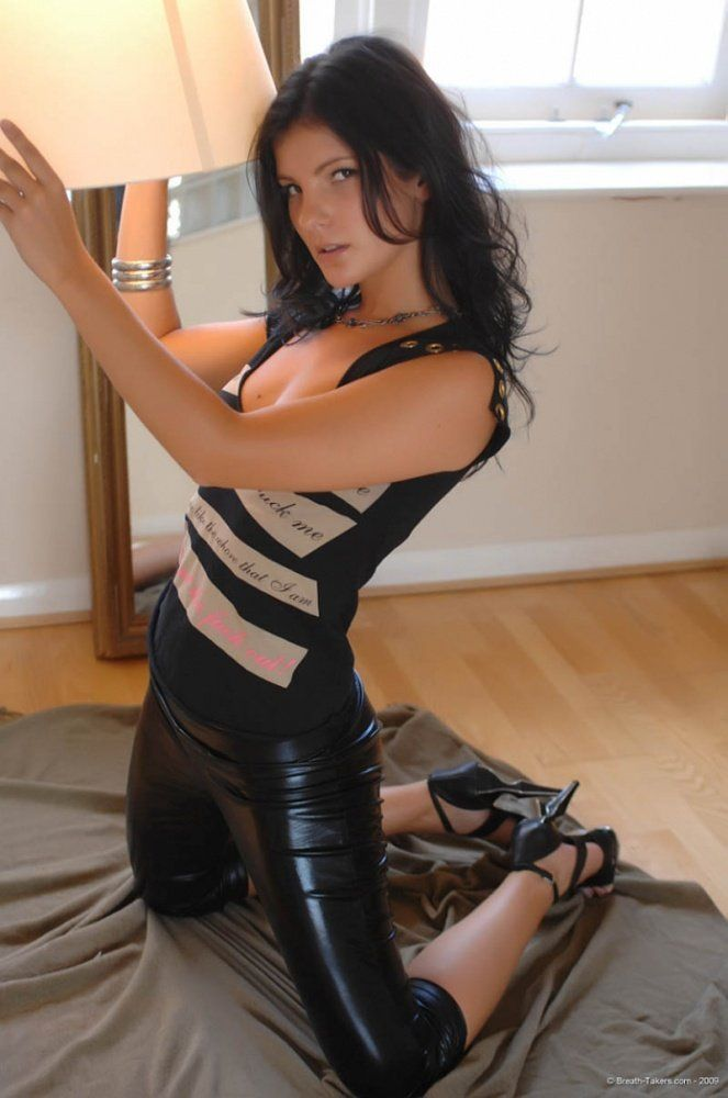 Cutie poses in leather pants - 04