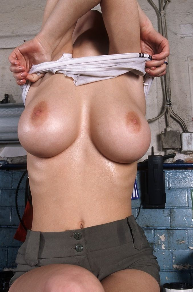 Busty babe in an auto repair shop - 20