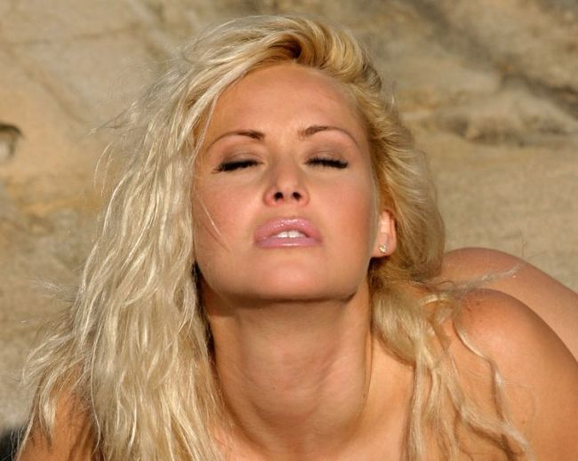 Gorgeous blonde Sasha in a photo shoot on a rocky beach - 00