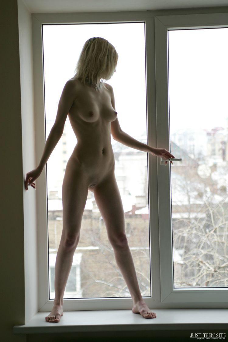 Wife nude in window