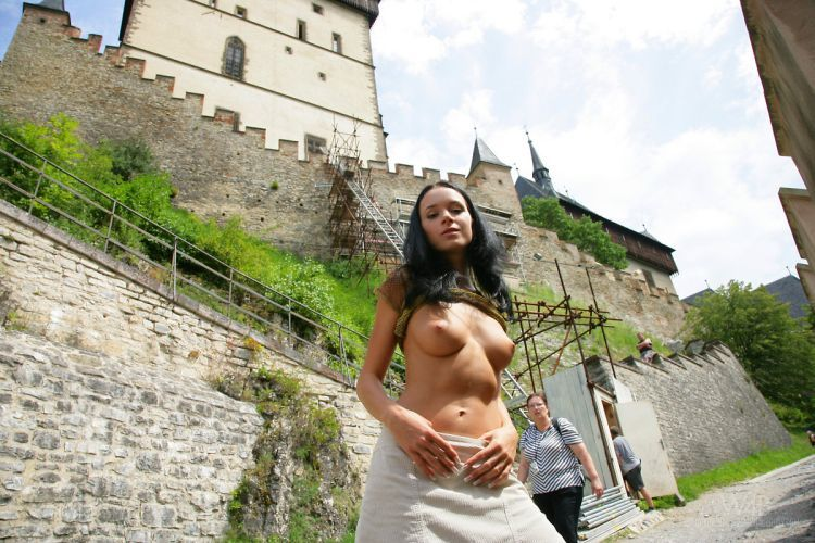 A girl who isn't afraid of posing nude in public places - 11