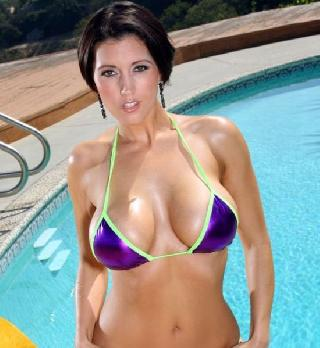 The beauty in bikini with fabulous breasts