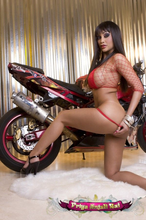 Indian porn star Priya Anjali Rai in a revealing photo shoot near a bike - 04