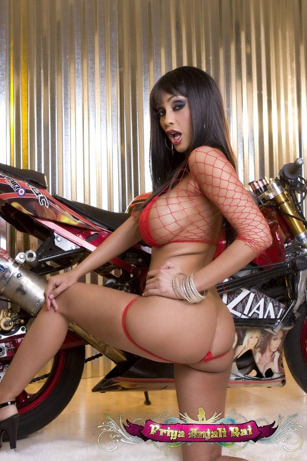 Indian porn star Priya Anjali Rai in a revealing photo shoot near a bike - 06