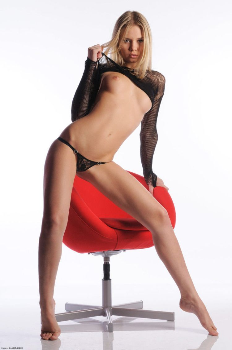 Cool blonde Aria posing at a red chair - 03