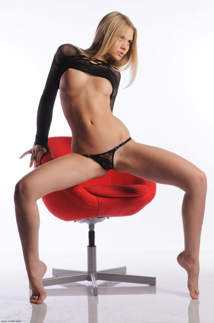 Cool blonde Aria posing at a red chair - 04