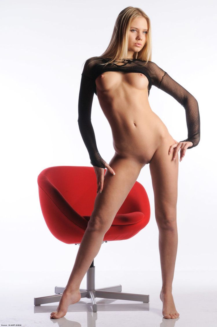 Cool blonde Aria posing at a red chair - 06