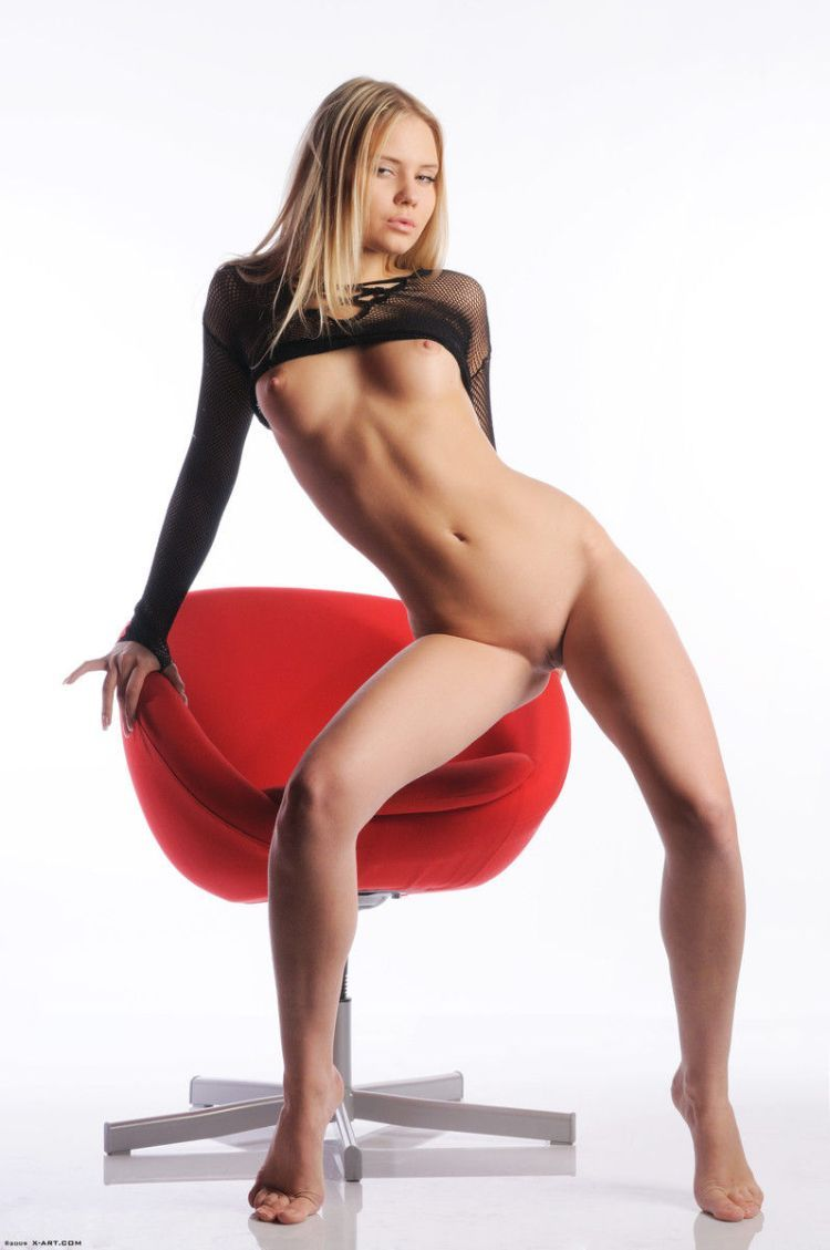 Cool blonde Aria posing at a red chair - 07