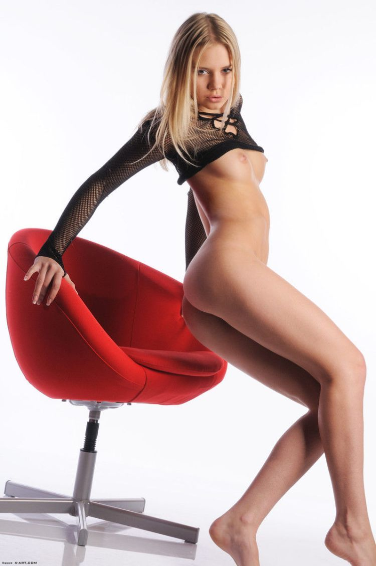Cool blonde Aria posing at a red chair - 08