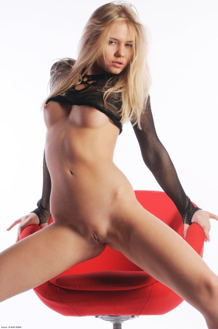 Cool blonde Aria posing at a red chair - 13