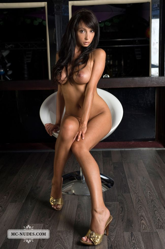 Gorgeous brunette Anna posing in a chair - 01