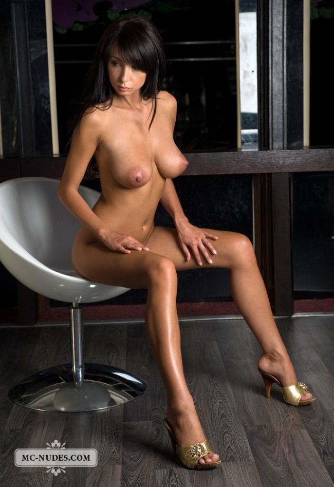 Gorgeous brunette Anna posing in a chair - 03