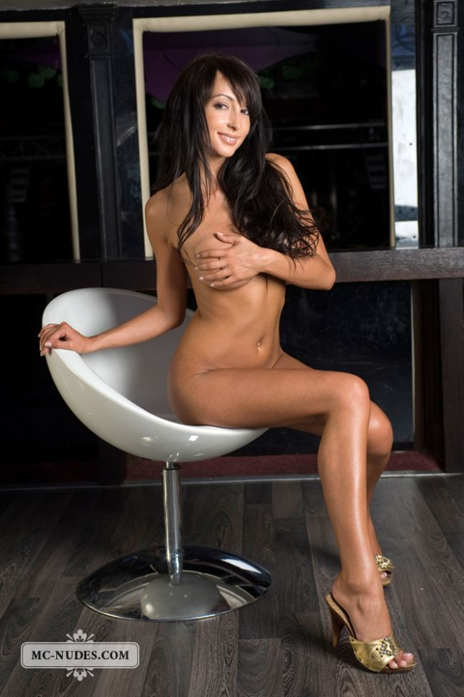 Gorgeous brunette Anna posing in a chair - 04