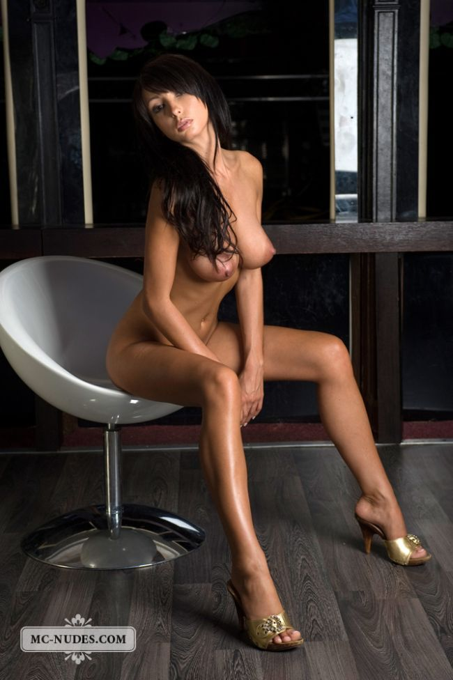Gorgeous brunette Anna posing in a chair - 14