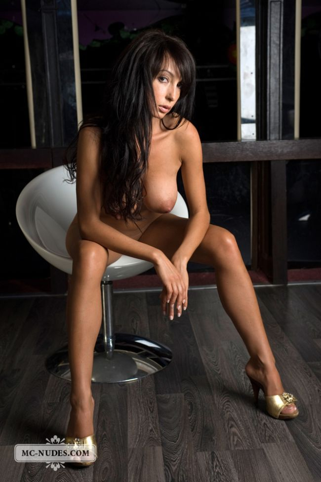 Gorgeous brunette Anna posing in a chair - 15