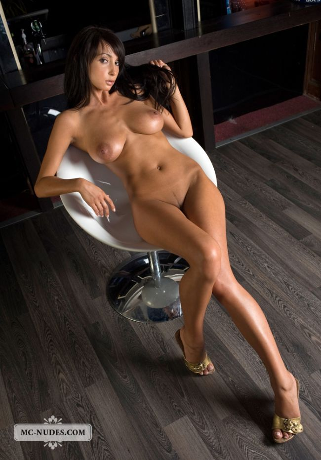 Gorgeous brunette Anna posing in a chair - 16