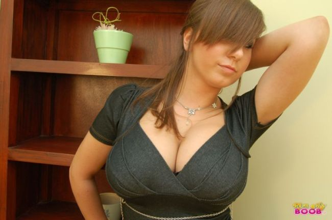 Milena demonstrates her huge natural tits - 00