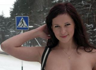 Nude babe at a bus stop. And it doesn't bother her that it is cold winter ;)