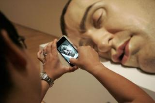 Hypernatural works of Ron Mueck at the exhibition in Melbourne