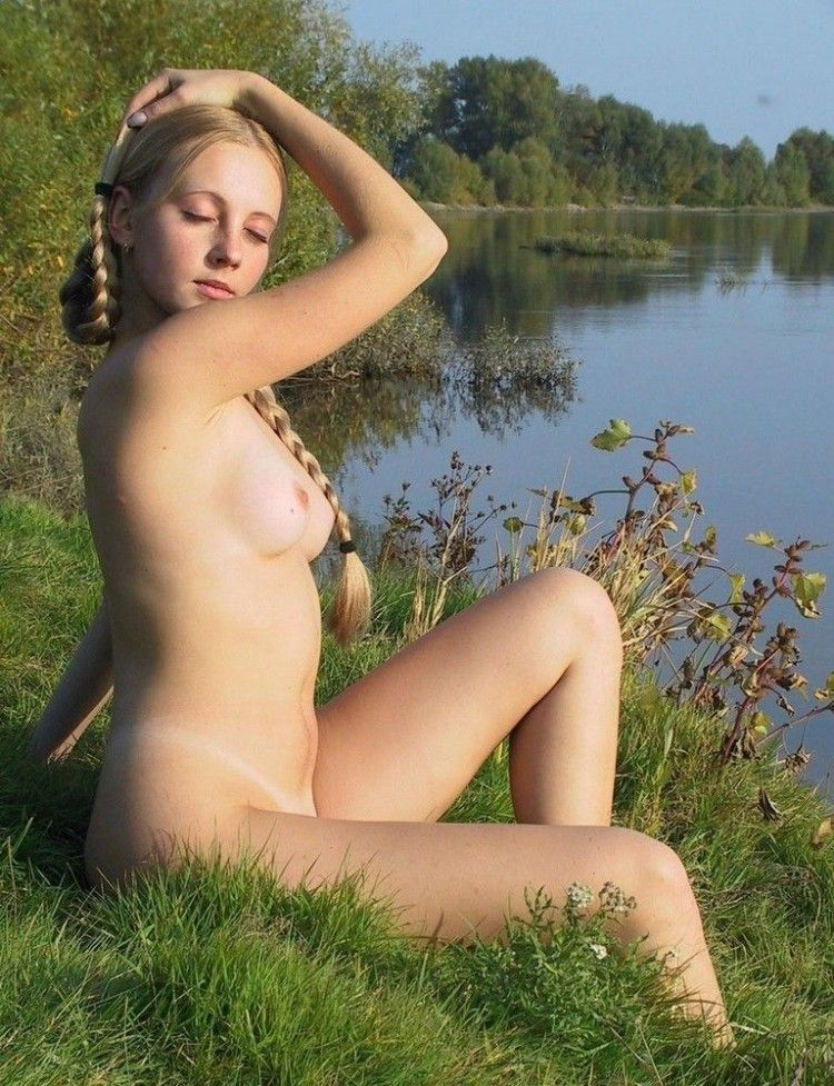 Cutie Alena posing on the river's bank - 01
