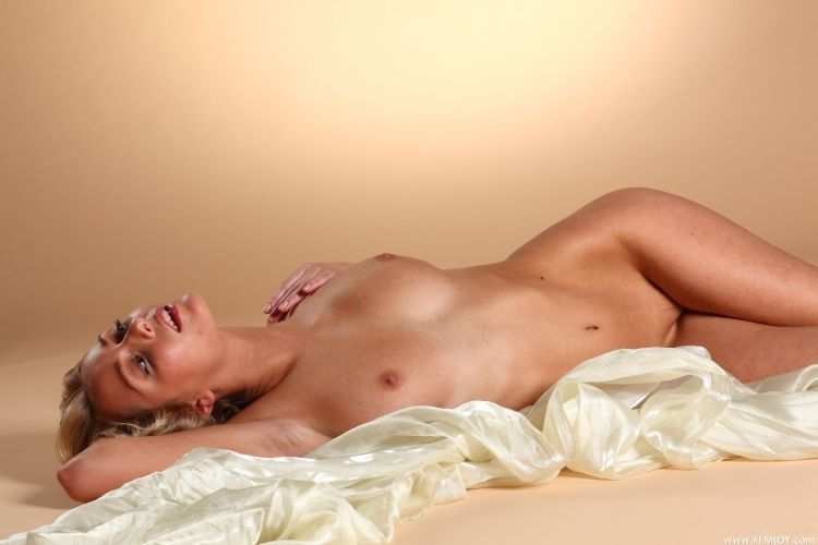 The charming blonde with a stunning body - 13