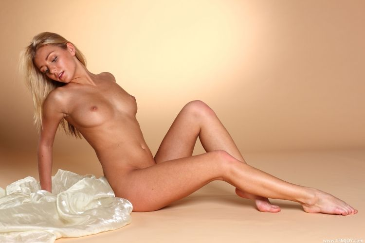The charming blonde with a stunning body - 23