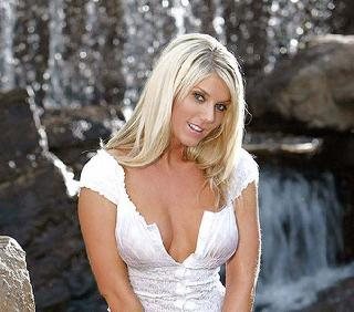 Gorgeous blonde Marie Morrison posing at a waterfall