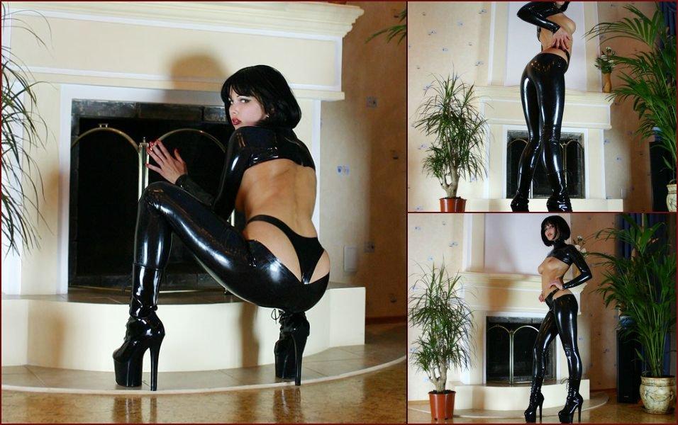 Brunette in black latex - 18