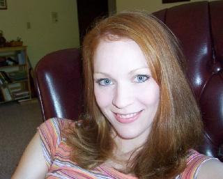 Home photo set of a redheaded seductress