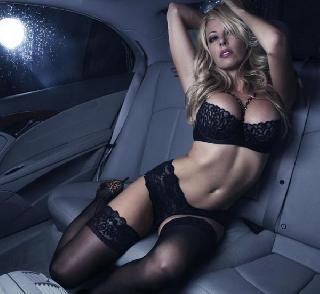 Blonde in black lingerie - seductive contrast