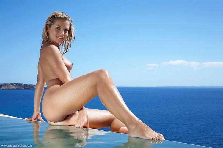 Beautiful blonde having fun in the pool - 03
